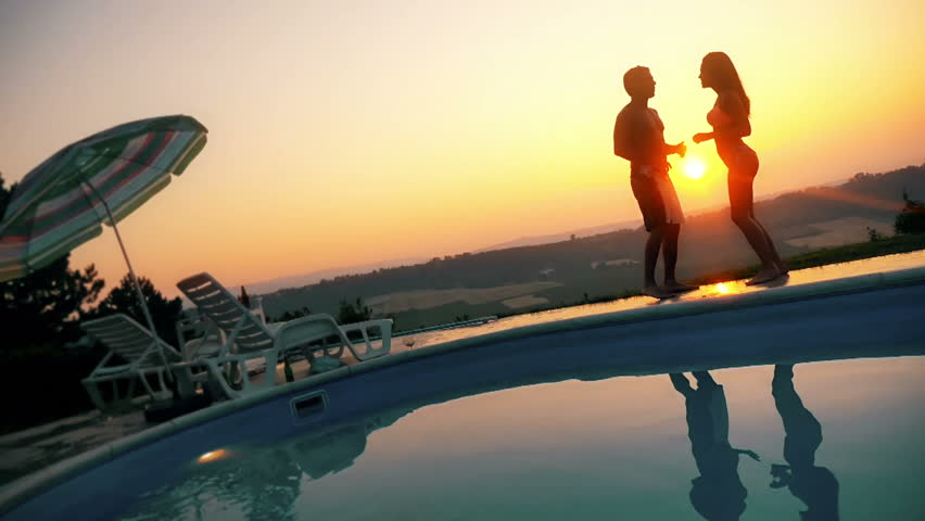 Romantic couple dancing in sunset #18709613