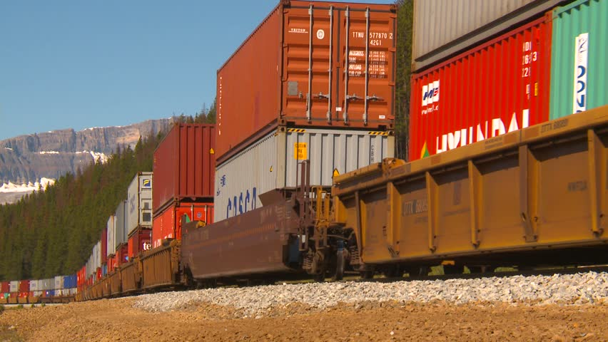 railroad, container rain, long lens into bend medium