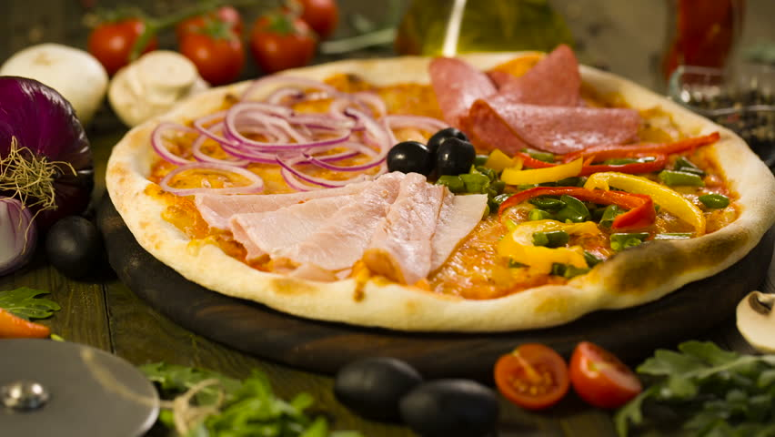 Tasty Pizza, and ingredients on background | Shutterstock Video #18754487