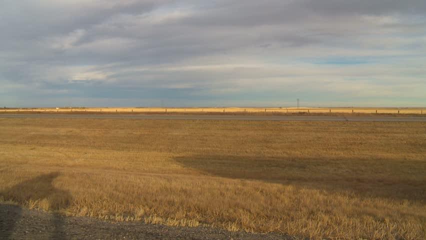 SOUTHERN ALBERTA, CANADA - CIRCA 2011 -  A rolled trailer along a highway. A series of wind storms rolled across the province i circa 2011 in Canada