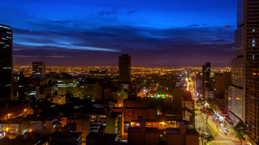 Day to night time lapse in Bogota, Colombia with the camera slowly zooming in