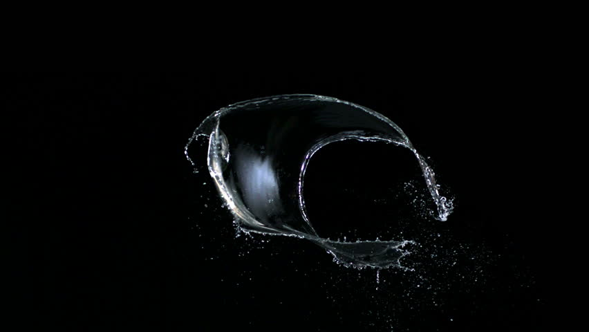 Water splash against black drop