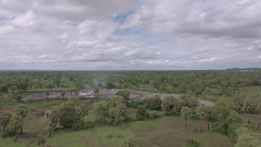 Aerial drone shot : flying slowly towards the local landfill site in the countryside | Shutterstock HD Video #18788933