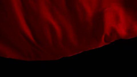 Red velvet cloth unfurled
