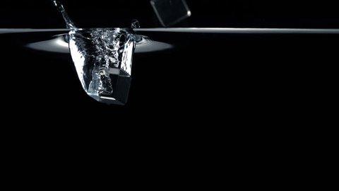 Slo-motion cubes falling through water