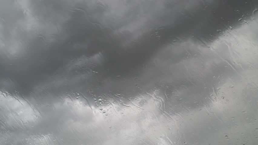Raining water drops on glass. Seasonal weather with storm clouds. | Shutterstock HD Video #18879353
