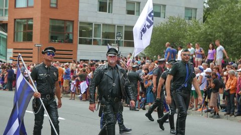 MONTREAL, CANADA - August 2016 : Men dressed in leather. Filmed During the 2016 annual LGBT gay pride parade festival in Montreal, Canada.