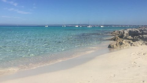 Awesome Cristal Blue Water Beach in Formentera Spain in a sunny day with very small waves.