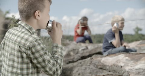 Kids are talking to each other with tin can phone