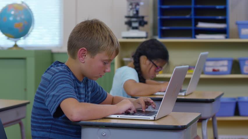 Students in school classroom working on laptop computers | Shutterstock HD Video #19004407