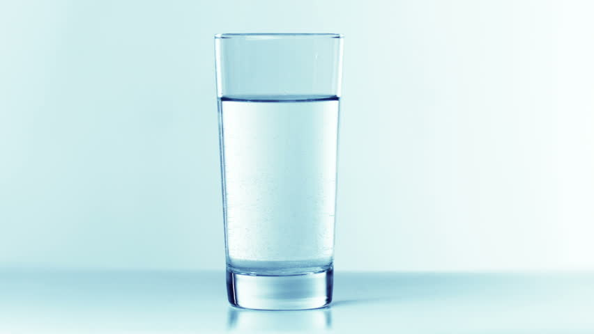 Two tablets fall into a glass of water. slow motion - 500fps | Shutterstock HD Video #1900483