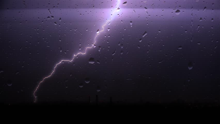 Strong thunderstorm with the rain over a city through window glass. | Shutterstock HD Video #19012663