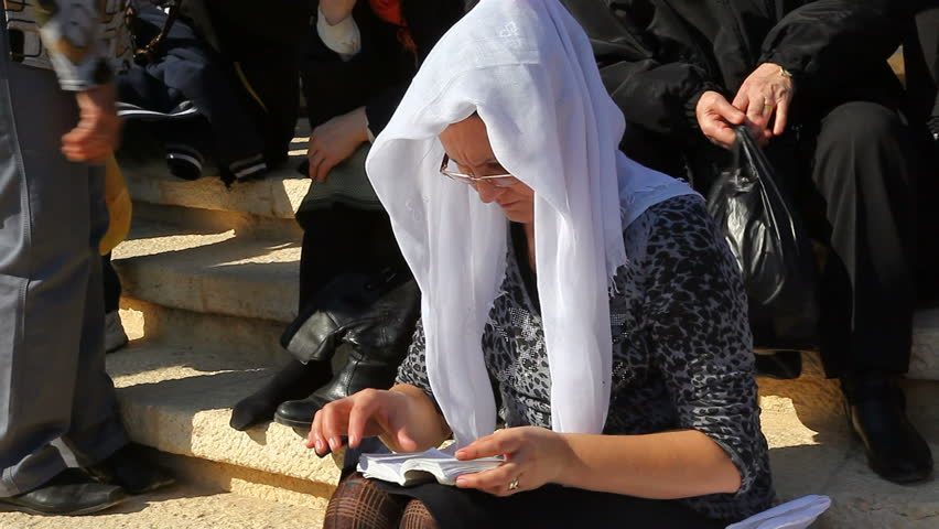 QASR AL YAHUD, ISRAEL - JANUARY 18: Pilgrim relaxes during the Epiphany at Qasr Al Yahud, Israel on January 18, 2012.