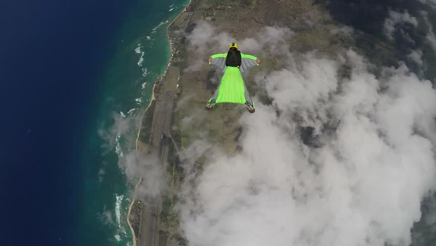 Lifestream men jumping with a wingsuit parachute over Hawaii, slow motion | Shutterstock HD Video #19033993