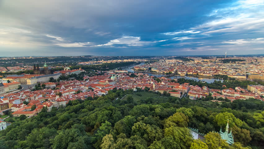 Wonderful timelapse View To The City Of Prague From Petrin Observation Tower In Czech Republic. Blue cloudy sky before sunset