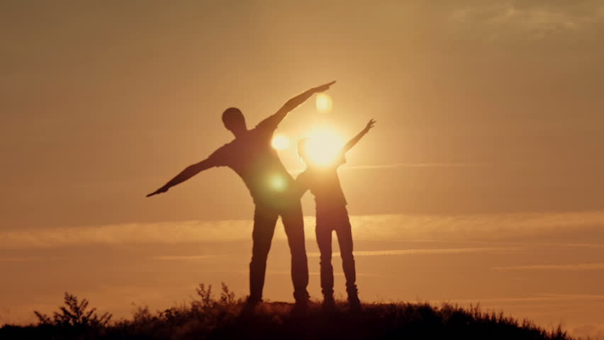 Father and son silhouettes play at sunset beach. Happy family | Shutterstock HD Video #19050244