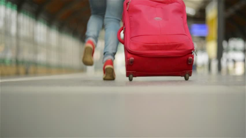 Girl Running with a suitcase in a train station | Shutterstock HD Video #19073203