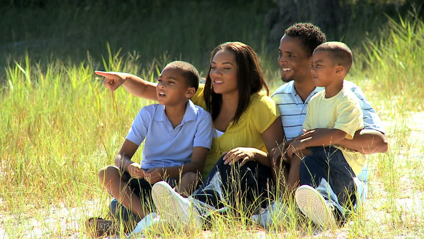 Portrait of happy young african american family enjoying the park