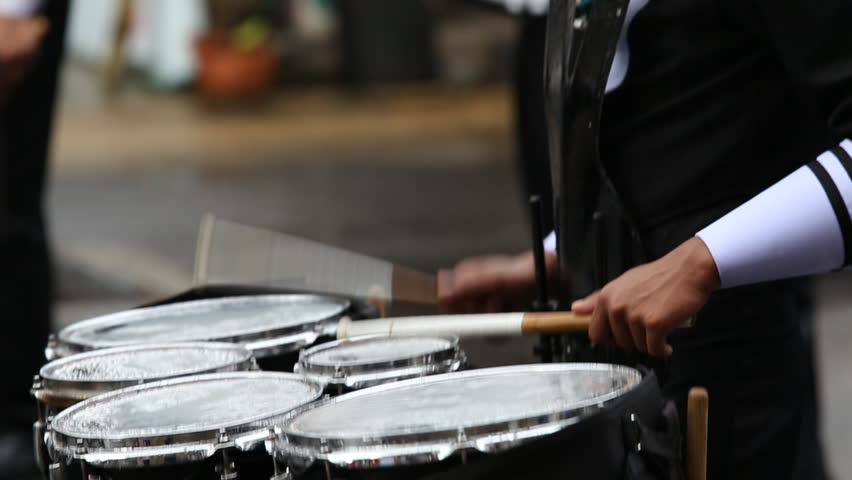 Drummers in a Marching Band. Drummers playing snare drums in parade