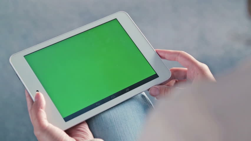 Woman looking at tablet with green screen. Close up shot of woman's hands with pad | Shutterstock HD Video #19120813