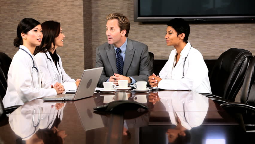 Multi ethnic medical executives meeting financial adviser