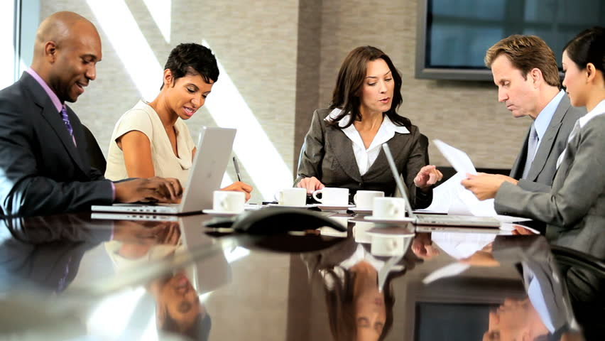 Female caucasian business executive in meeting with her multi ethnic team