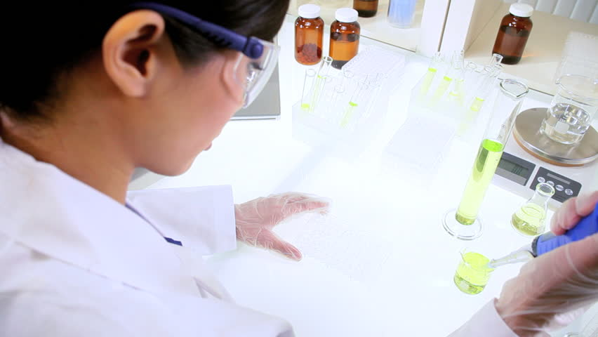 Young Asian Chinese Research Assistant Conducting Medical Research ...