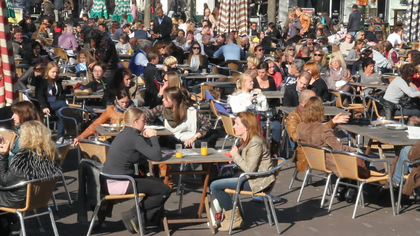 THE HAGUE, HOLLAND - OCTOBER 15 - People sit on a cafe terrace in a The Hague town square on October 15, 2011.