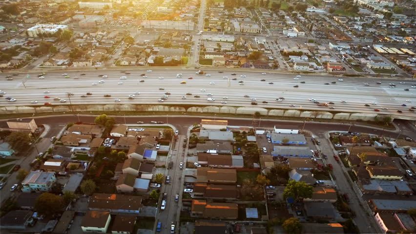 Freeway at sunset in Los Angeles, California. traffic passing by. Aerial footage. United States. | Shutterstock HD Video #19331353