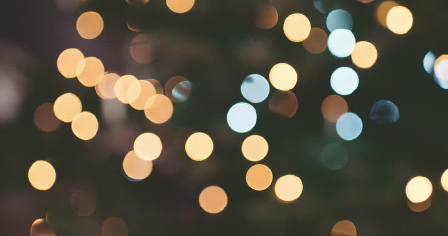 Abstract Blurred Christmas Lights Bokeh Background. 4K DCi SLOW MOTION 120 fps. Blinking Christmas Tree Lights Twinkling. Winter Holidays Concept. DOLLY SHOT | Shutterstock HD Video #19337476