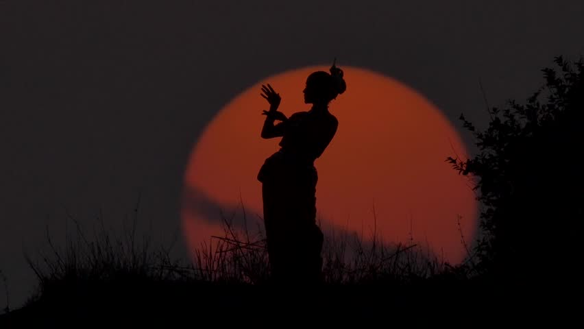 Silhouette girl oriental dancer a dance on sunset | Shutterstock HD Video #19349503