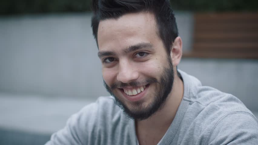 Portrait of Attractive Smiling Hispanic Ethnicity Young Man in Urban Environment. Shot on RED Cinema Camera in 4K (UHD).   Shutterstock HD Video #19367110