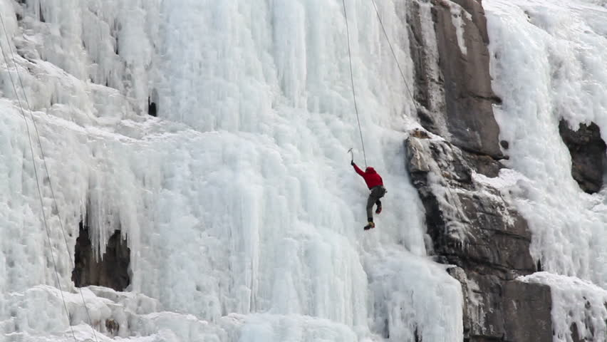 Man ice climbing steep high mountain frozen waterfall ice in Utah. Winter recreation and sports in nature. | Shutterstock HD Video #1951921