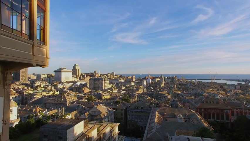 Genoa, Italy, Cityscape with historical center and sea port view from esplanade of Castelletto at summer day. Aerial view