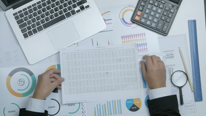 Financial specialist, businessman working with blueprint, graph at his workplace.   Shutterstock HD Video #19526731