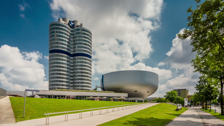 MUNICH, GERMANY - JULY 27, 2016: Hyperlapse video of BMW World (BMW Welt) with Olympic Tower near the Olympicpark in Munich, Germany. Timelapse view in 4K.
