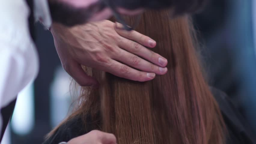 Stylist at work. Hairdresser works. Hands male stylist. Comb the hair ends. Beauty salon, haircut, styling, hairdresser. | Shutterstock HD Video #19593043