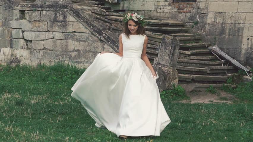 Smart bride in wedding dress walking and posing. Slow motion | Shutterstock HD Video #19597021