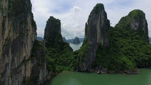 A suggestion aerial video in ha long bay, vietnam. An aerial video near the rocks, in a beautiful day.