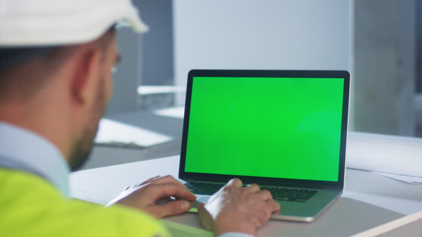 Engineer using Laptop Computer with Green Screen inside Building Under Construction. Great for Mockup usage. Shot on RED Cinema Camera in 4K (UHD). | Shutterstock HD Video #19625683