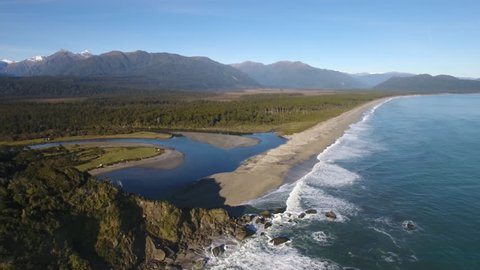 Spectacular aerial shot of Bruce Bay and the Southern Alps, New Zealand