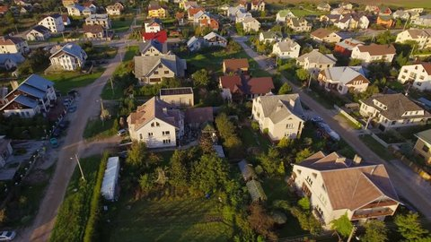 Suburban residential neighborhood houses district aerial view.