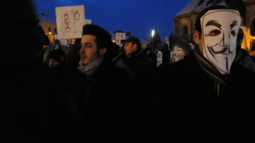 CLUJ NAPOCA - FEBRUARY 11: Hundreds of people protest against ACTA, against web piracy treaty, and against government on February 11, 2012 in Cluj Napoca, Romania.