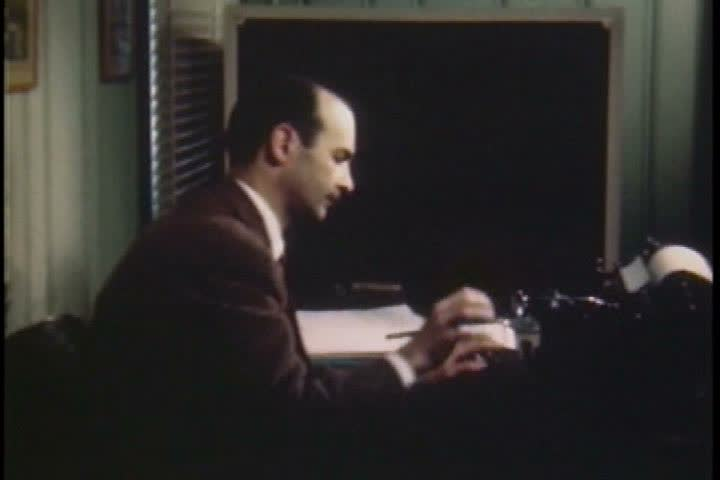 Eddie Paul sits down at a piano to compose a score for Jerry Fairbanks Studios in 1946. (1940s) | Shutterstock HD Video #19744243