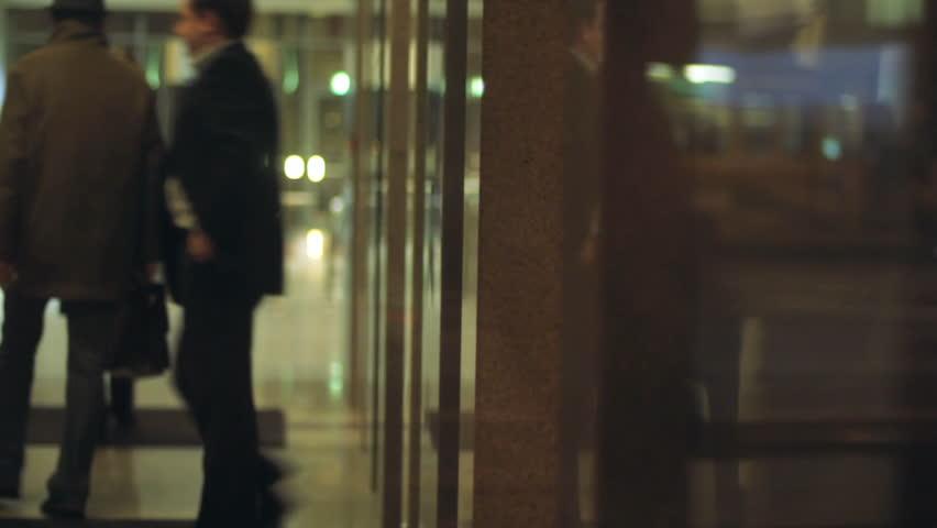 Businessman leaving office elevator _ blurred