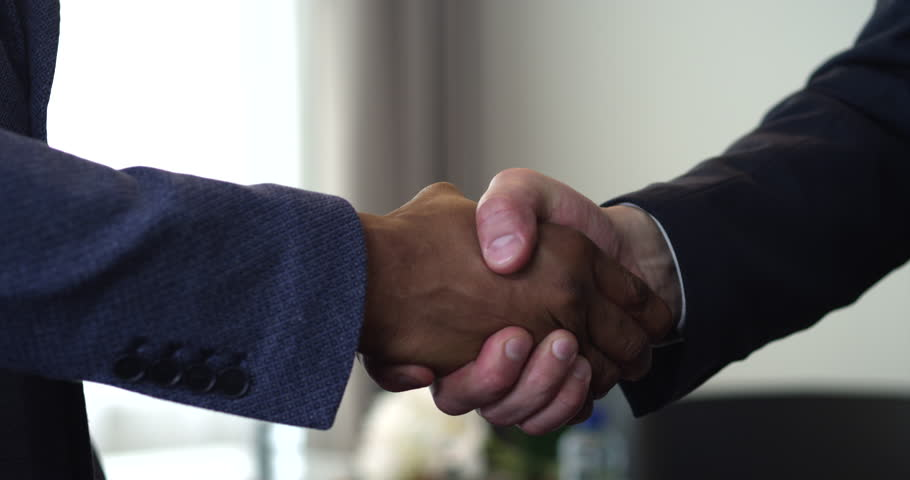 We see a handshake between two businessmen. The agreement between them had been reached. One of them is an African American/Handshake of Two Businessman - is the Completion of the Transaction | Shutterstock HD Video #19786783