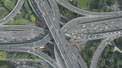 Overhead aerial drone shot of the massive Yan'an elevated highway interchange, one of the busiest junctions in Shanghai, urban China.