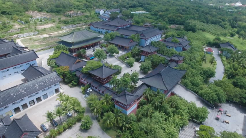 Aerial view of a large Buddhist temple complex on tropical Hainan island, Buddhism religion in China.