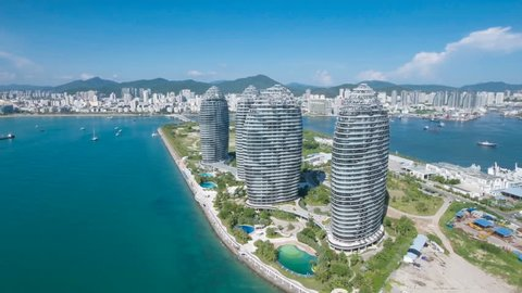 SANYA, CHINA - JULY 2016: Aerial view of futuristic modern hotel and shopping complex on Hainan island in the South China Sea.