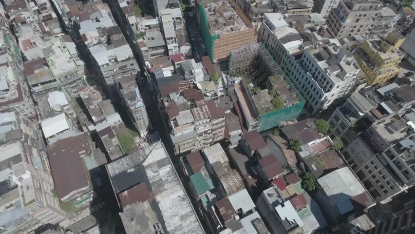 MACAU - JULY 2016: Aerial footage flying over residential buildings in Macau, slowly revealing the modern skyline with various casino gambling venues.